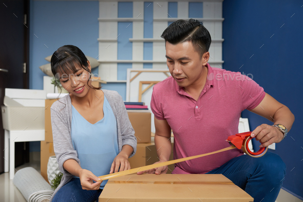 Couple Packing Boxes - Stock Photo - Images