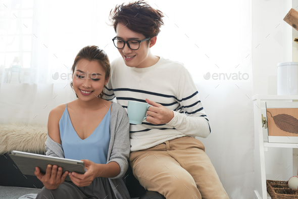 Couple with digital tablet - Stock Photo - Images