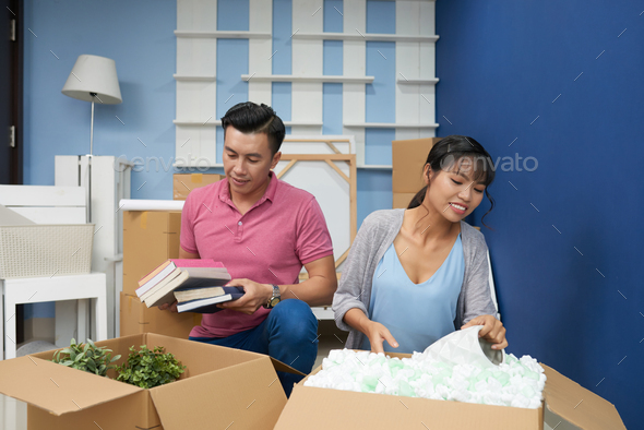 Couple Unpacking In New Flat - Stock Photo - Images