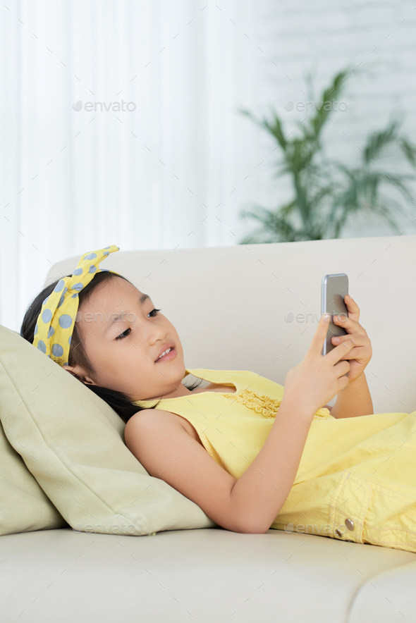 Texting little girl - Stock Photo - Images