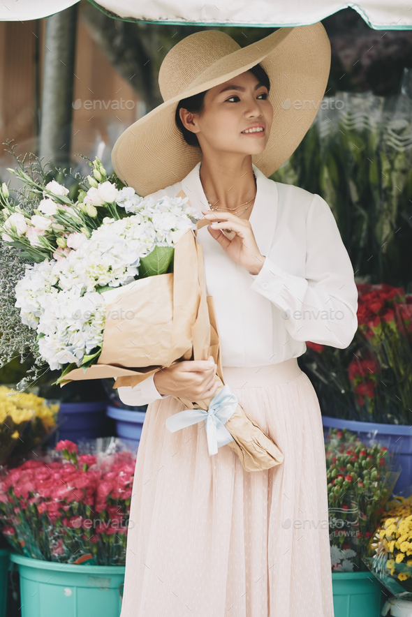 Charming lady with flowers - Stock Photo - Images