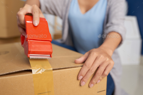 Woman Packing Box With Tape - Stock Photo - Images