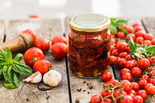 Sun dried tomatoes in glass jar - Stock Photo - Images