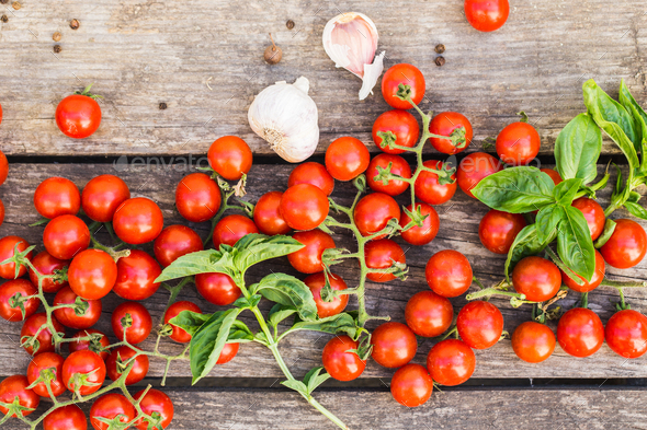 Fresh cherry tomatoes on a wooden table. - Stock Photo - Images