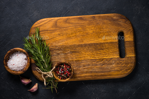 Food cooking background with herbs and spices on black - Stock Photo - Images