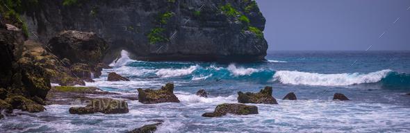 Ocean Waves on Tembeling Coastline at Nusa Penida island, Bali Indonesia - Stock Photo - Images