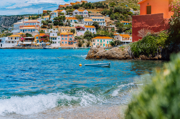 Beautiful sailing yacht near picturesque seacoast. Assos village Mediterranean Sea, Greece. Summer - Stock Photo - Images