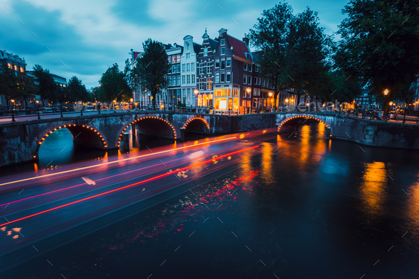Amazing Light trails and reflections on water at the Leidsegracht and Keizersgracht canals in - Stock Photo - Images