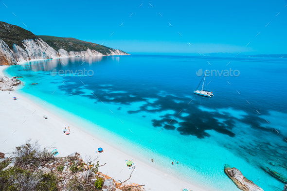 Lonely white catamaran yacht drift in clear blue Caribbean like sea water. Tourists leisure activity - Stock Photo - Images