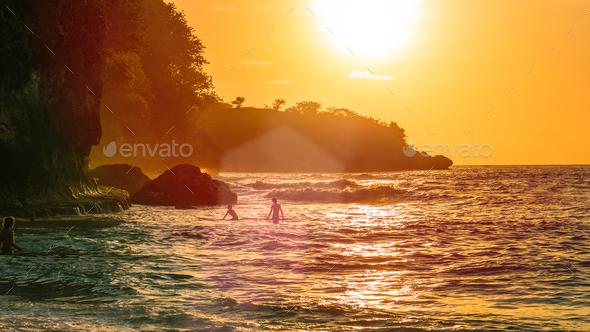Sunset on beautiful Crystal Bay, Nusa Penida, Bali, Indonesia - Stock Photo - Images