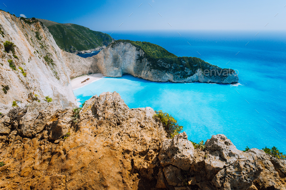 Rock Cliffs in front of Navagio beach Zakynthos. Shipwreck bay with turquoise water and white sand - Stock Photo - Images