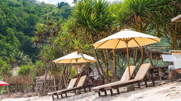 Sunbed on White Sand under Palms - Atuh Beach, Nusa Penida, Bali, Indonesia - Stock Photo - Images