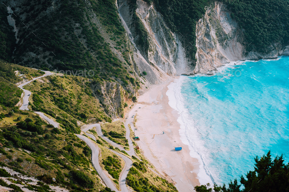 Alone tourist tent on famous Myrtos Beach. Big foam waves rolling towards the bay. Kefalonia, Greece - Stock Photo - Images