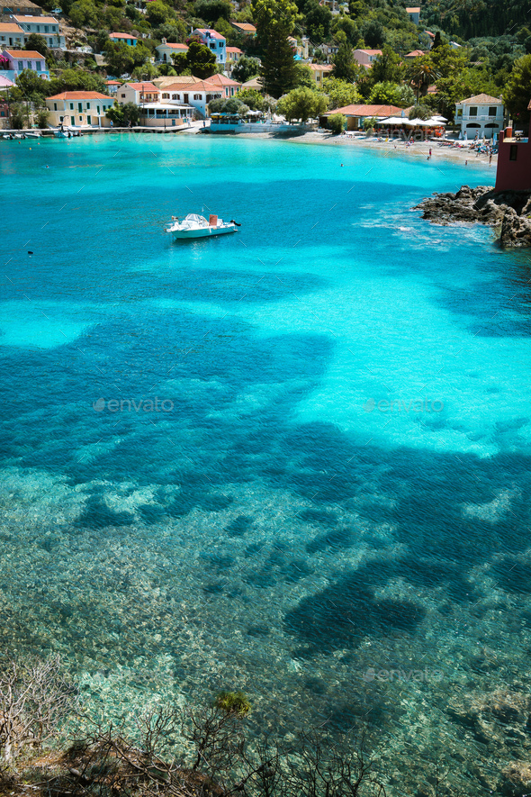 Assos village, Kefalonia Greece. Transparent turquoise emerald green sea water with dark pattern on - Stock Photo - Images