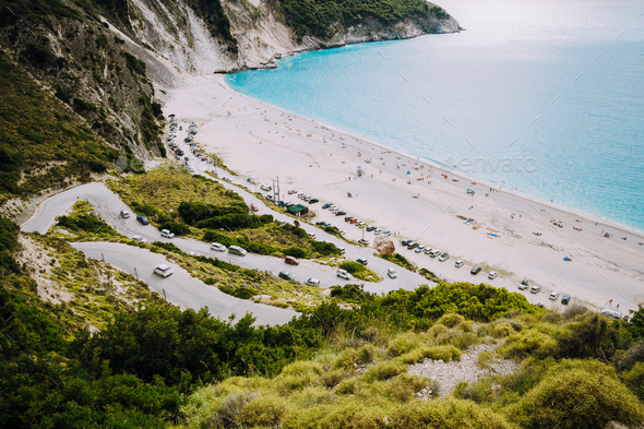 Serpentine road lead to Famous Myrtos Beach. Most visited place on Kefalonia during cruise travel - Stock Photo - Images