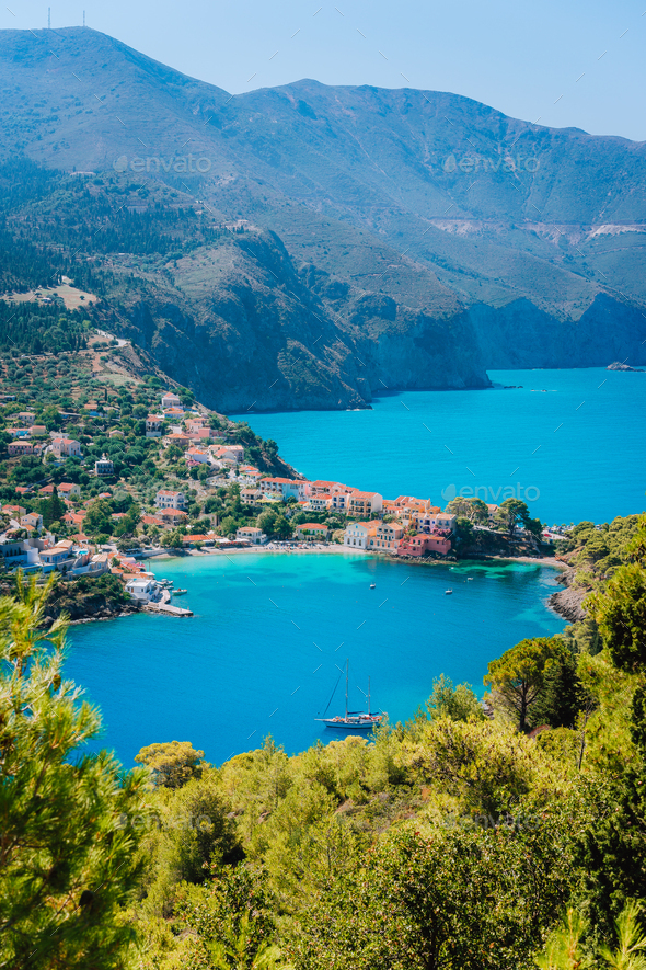 Mediterranean seashore in Greece. Beautiful turquoise colored Assos bay water surrounded by pine and - Stock Photo - Images