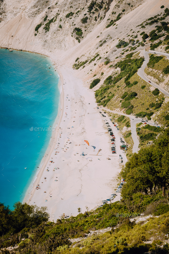 Myrtos beach, Kefalonia island, Greece. Beautiful top view of bay and beach with tourists from above - Stock Photo - Images