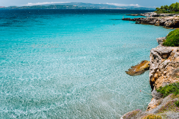 Cristal clear turquoise sea water. Seaside beach lagoon and scenery coastline of Kefalonia island - Stock Photo - Images