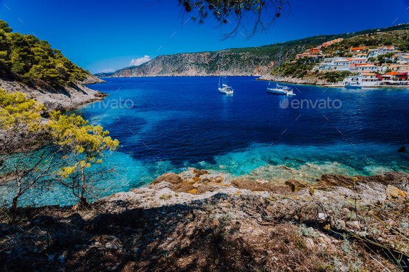 Amazing Greece, white sail boats in blue bay of picturesque colorful village Assos in Kefalonia - Stock Photo - Images