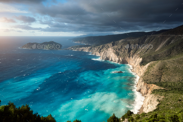 Dreamy atmosphere on picturesque jagged coastline of Kefalonia. Overcast weather, deep clouds - Stock Photo - Images