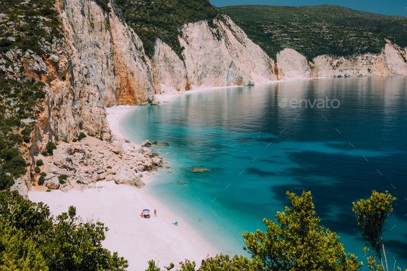 Fteri beach. Blue lagoon with rocky coastline, Kefalonia, Greece. Calm clear blue emerald green - Stock Photo - Images