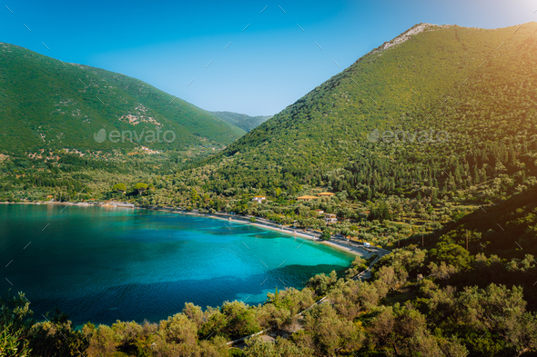 Antisamos beach on Kefalonia island, Greece. Crystal clear water, huge hills overgrown with - Stock Photo - Images