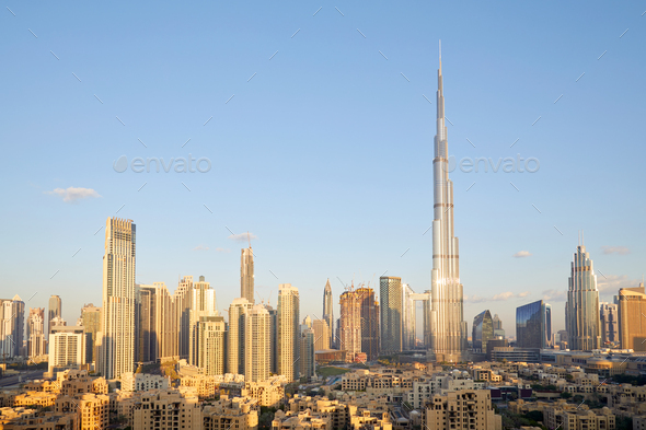 Dubai city skyline with Burj Khalifa skyscraper in a sunny day, blue sky - Stock Photo - Images