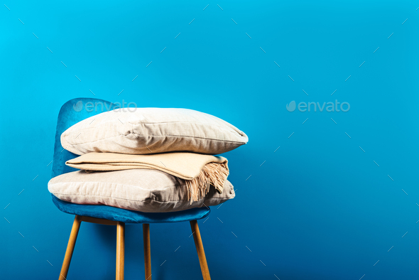 Modern Blue Velour Chair with Beige Cushions and Throw - Stock Photo - Images