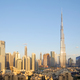 Dubai city skyline with Burj Khalifa skyscraper in a sunny day, blue sky - PhotoDune Item for Sale