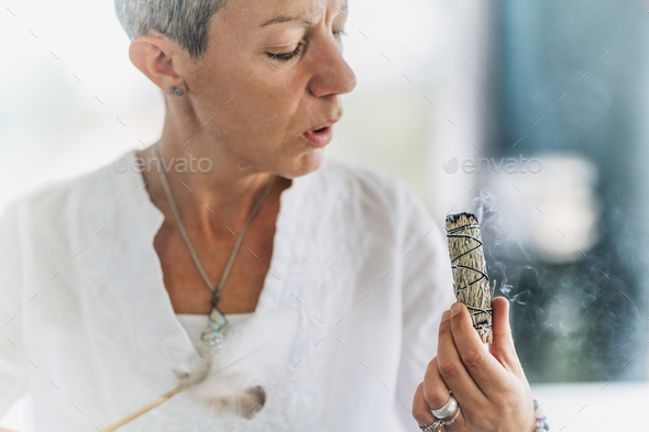 Smudging or Space Cleansing - Burning Sage to Bless and Cleanse Out the Negative Energy - Stock Photo - Images
