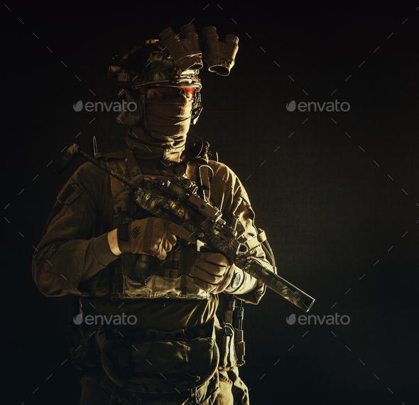 Portrait of elite commando fighter in darkness - Stock Photo - Images