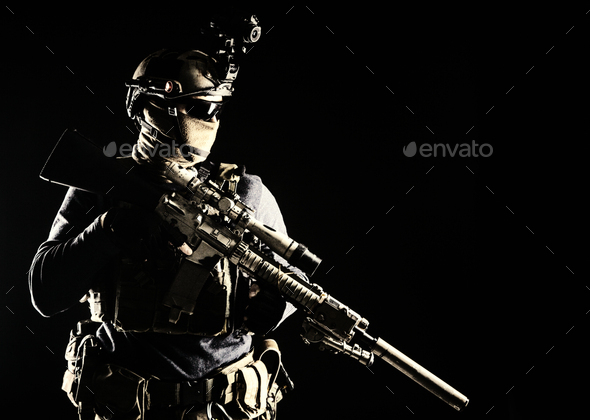 Army marksman with sniper rifle in darkness - Stock Photo - Images