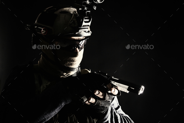 Police SWAT team fighter aiming service pistol - Stock Photo - Images