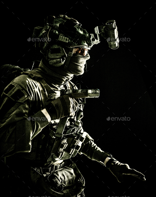 Military security service fighter sneaking in dark - Stock Photo - Images