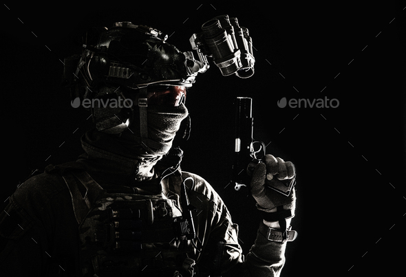 Combatant armed with service pistol in darkness - Stock Photo - Images