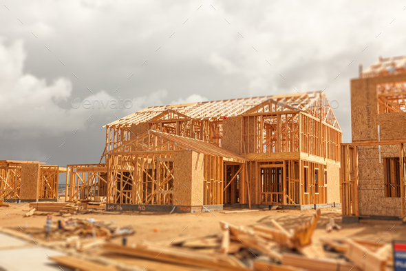 Wood Home Framing Abstract At Construction Site with Stormy Clouds Behind - Stock Photo - Images
