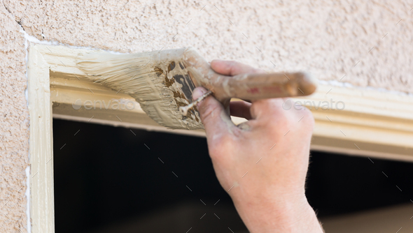 Professional Painter Cutting In With Brush to Paint House Door Frame. - Stock Photo - Images