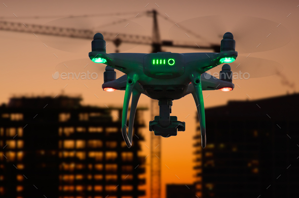 Silhouette of Drone In The Air Over Buildings Under Construction - Stock Photo - Images