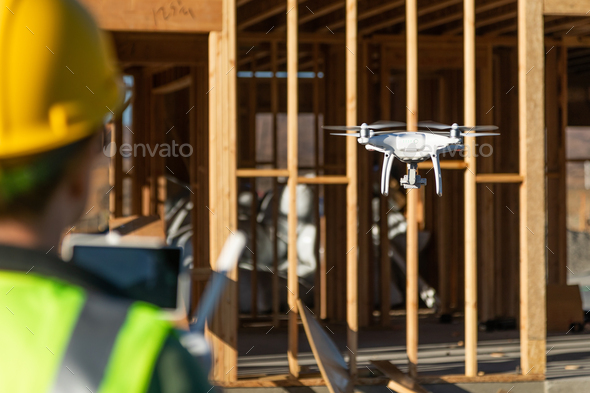 Female Pilot Flies Drone Quadcopter Inspecting Construction Site - Stock Photo - Images
