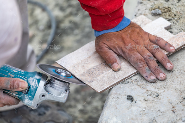 Worker Grinding Corner Tile for Fitting - Stock Photo - Images