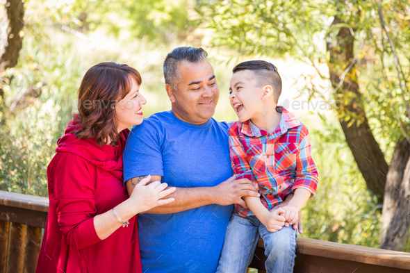 Mixed Race Caucasian and Hispanic Family At The Park. - Stock Photo - Images