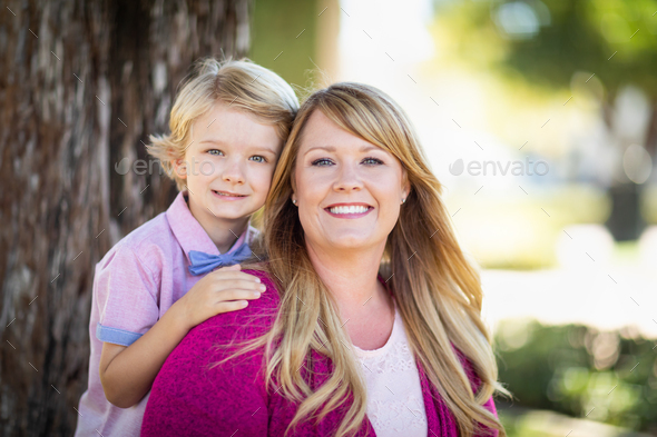 Young Caucasian Mother And Daughter Portrait At The Park - Stock Photo - Images