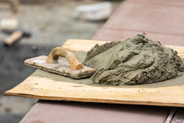 Wood Float Sitting Near Wet Cement On Board At Construction Site - Stock Photo - Images
