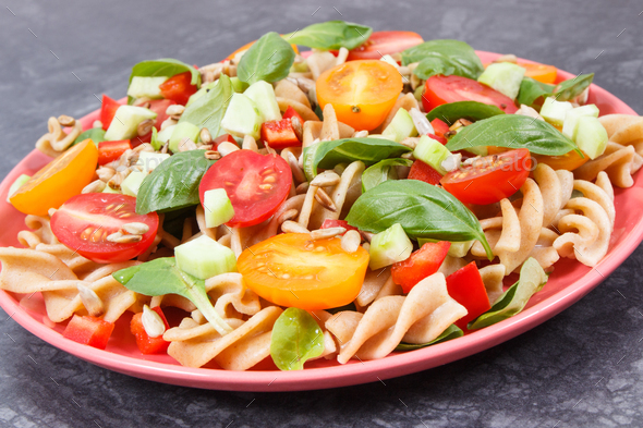 Fresh salad with wholegrain pasta and vegetables. Healthy lifestyles and nutrition - Stock Photo - Images