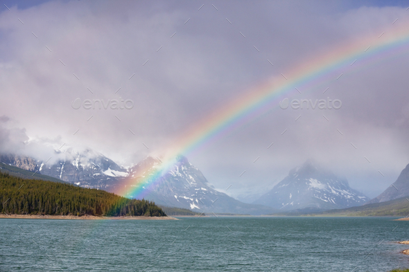 Rainbow in mountains - Stock Photo - Images