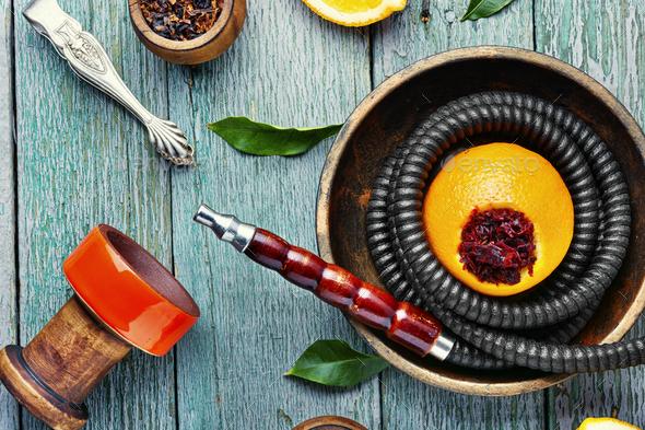 Oriental hookah with orange flavor. - Stock Photo - Images