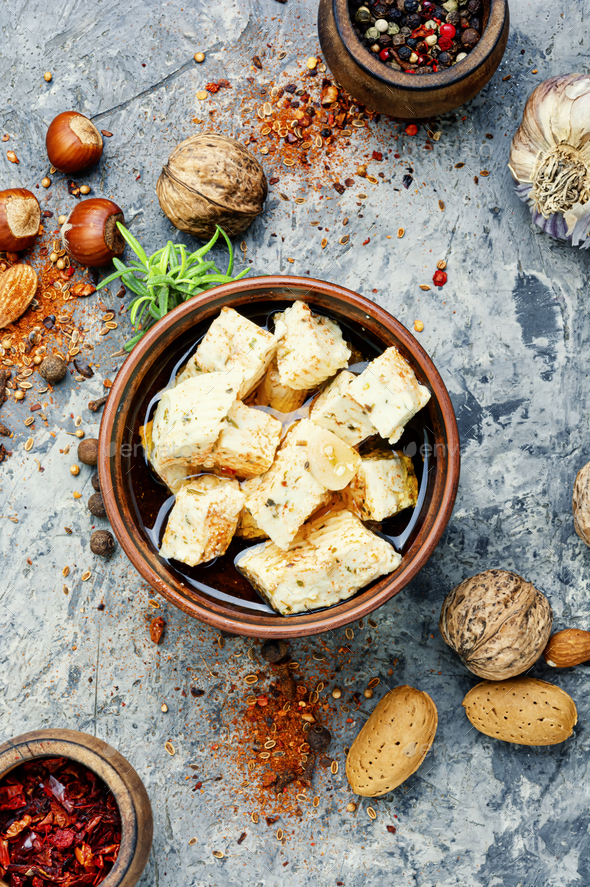 Homemade feta cheese with herbs - Stock Photo - Images