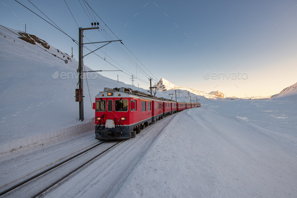 Red train in the snow - Stock Photo - Images