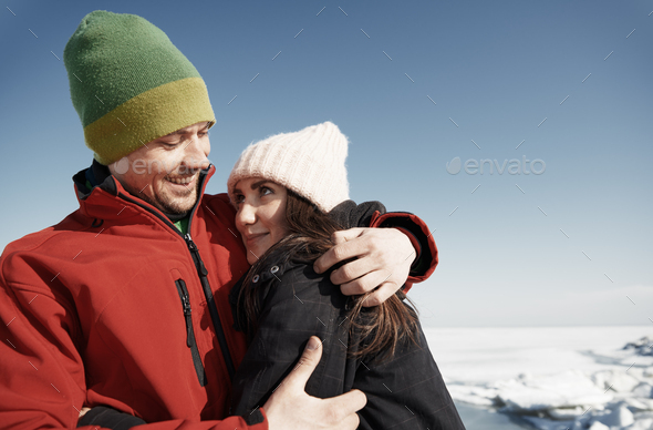 Young adult couple having fun in winter landscape - Stock Photo - Images