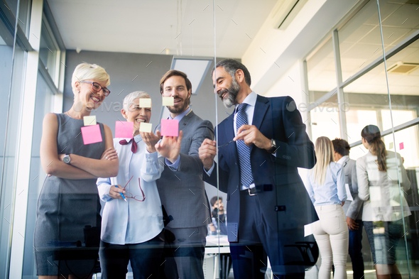 Collaboration and analysis by business people working in office - Stock Photo - Images